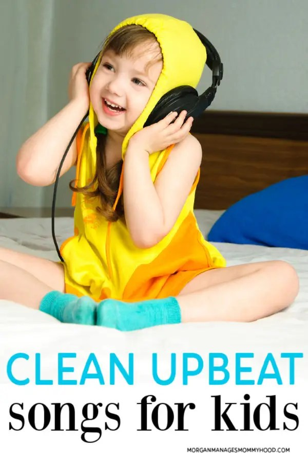a little girl in a yellow shirt listening to upbeat songs for kids through large black headhones