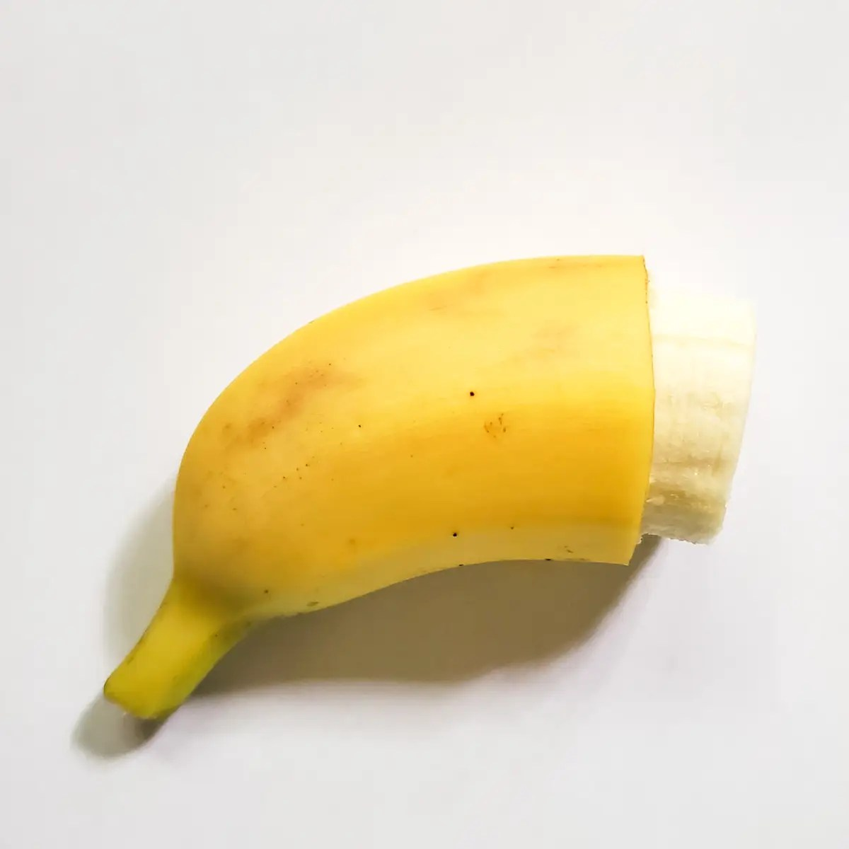a banana with most of the peel on it showing how to serve a banana for blw