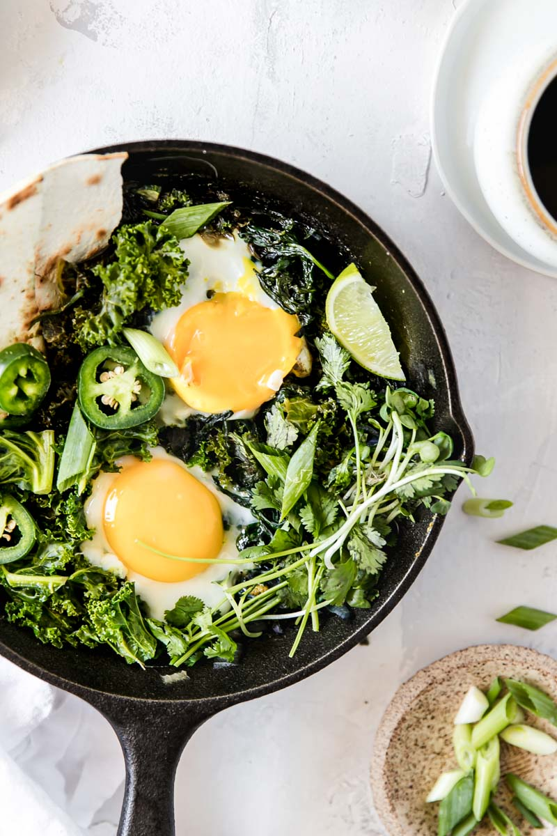 This Herby Green Curried Shakshuka is made with coconut milk and green curry spice for a healthy dairy-free twist on the classic brunch egg dish.