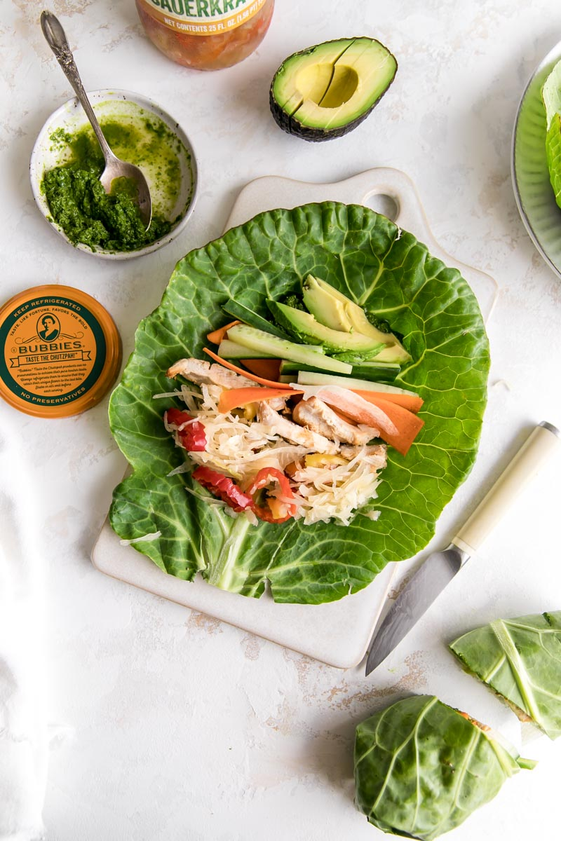 These Grilled Chicken Collard Green Wraps with Spicy Bubbies Sauerkraut are one of my favorite Paleo/keto lunches that come together quickly. An easy vegan kale pesto and spicy sauerkraut make these wraps anything but boring!