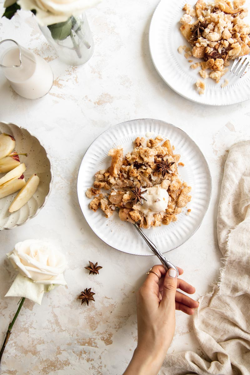 This easy and healthy paleo apple crisp is made with warm cinnamon apples and a grain-free, refined-sugar-free crisp topping that melts in your mouth. The perfect vegan and paleo fall dessert!