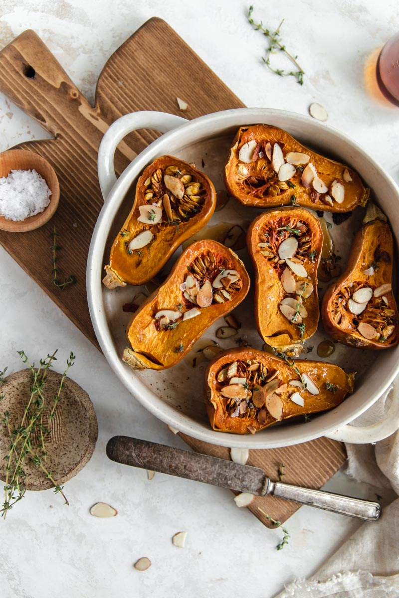 Sweet and savory Maple Thyme Honeynut Squash is the perfect easy paleo and gluten-free side dish! A side dish I'll be sure to have on my Thanksgiving table this year.
