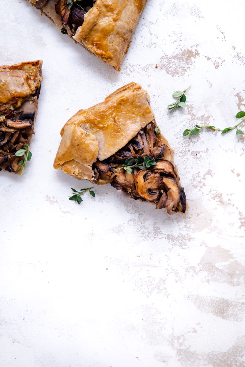 This easy Grain-Free Mushroom and Sauerkraut Galette is made with a flavorful blend of mushrooms, shallots, and crunchy sauerkraut for the most delicious gluten-free savory galette!