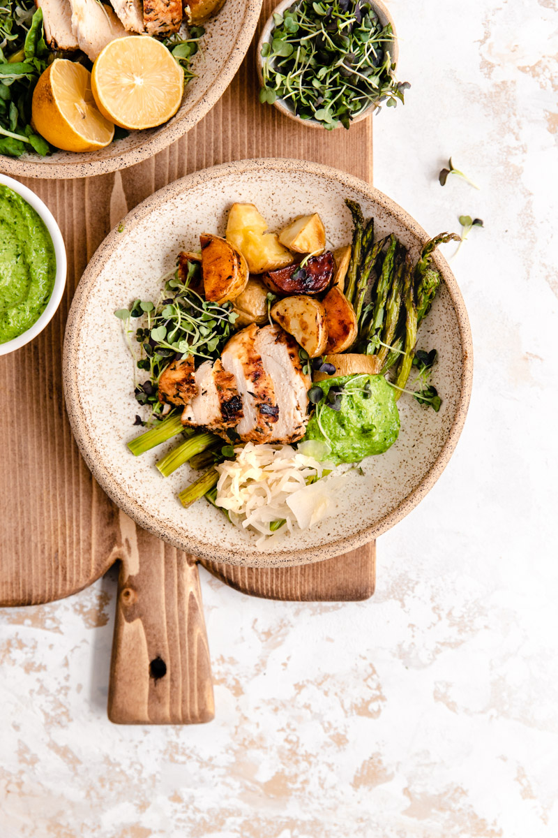 Easy Gluten-Free Pesto Chicken Bowls with Sauerkraut are made with sheet-pan roasted vegetables and topped with dairy-free pesto and sauerkraut for an easy weeknight dinner.
