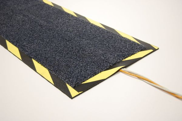 Morland cable Protect Mat covering a single yellow cable on a white background