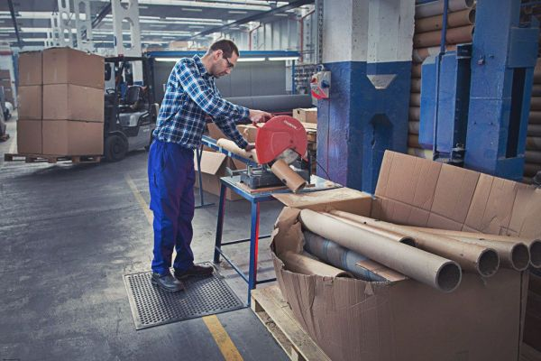 man at a workstation standing on a Morland Active Industrial Rubber Anti-Fatigue Mat