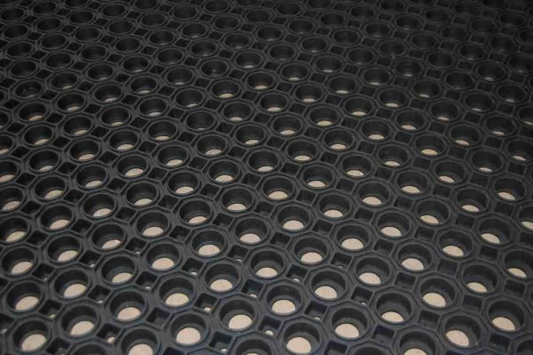 A close up of Morland Robust Industrial Rubber Doormat with full drainage holes