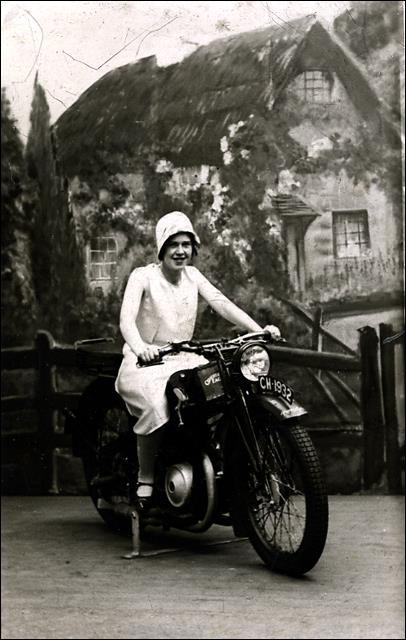 Annie Sanderson (nee Akeroyd) on a motorbike at Blackpool