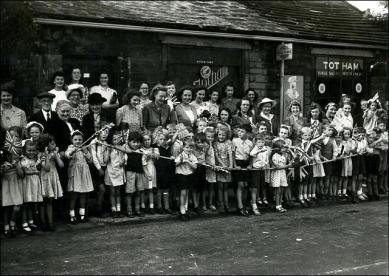 School children outside George Totham's sweet shop, awaiting a Royal motorcade