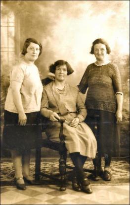 A studio photo of three Clough sisters