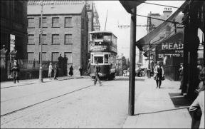 The surrounds as a tram passes the junction of Queen Street and Wesley Street