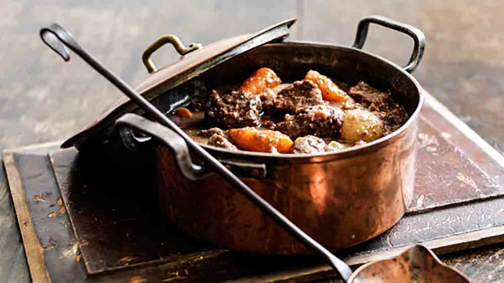 beef casserole with chestnuts in copper pan