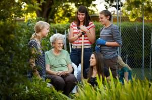 LDS teens serving an elderly woman through yard work
