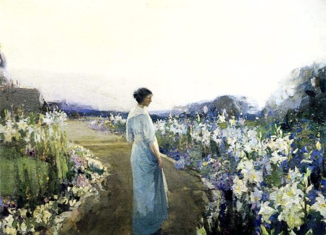 A path bordered by Lilies curves away into the distance, with the artist's wife in the foreground admiring the gorgeous display of blooms