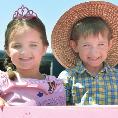 """Hannah and Connor McMahon ride the pink cadillac along the """"Vegas Strip."""""""