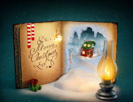 Old Christmas book next to oil lamp and elf shoes