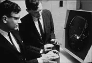 Men playing Spacewar