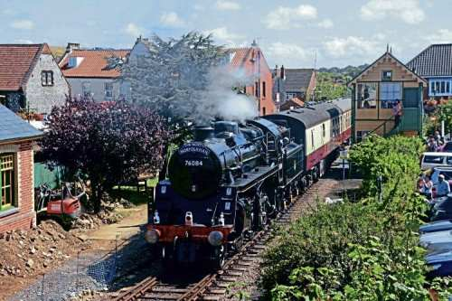 BR Standard 4MT 2-6-0 No. 76084 brings up the rear of the North Norfolk Railway's first dining train to Cromer as it departs from Sheringham on its first main line run in preservation on August 10. BRIAN SHARPE