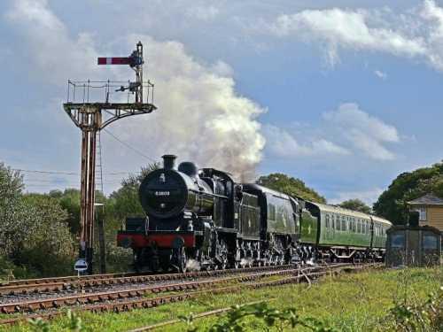 No. 53809 and No. 34070 Manston depart from Harmans Cross. JAMES CORBEN
