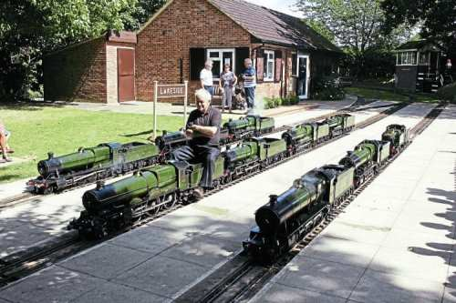 Tony Newberry pictured on 'King' class 4-6-0 No. 6026 King John, completed in 1992. He is surrounded by some of his locos, gathered together from various owners and railways, at Coate Water Miniature Railway on August 13. PETER NICHOLSON