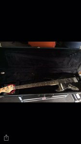 black Mexican Fender Jazz Bass (left handed) with rosewood neck and black pickguard