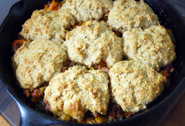 Sausage peppers and onions skillet with drop-biscuit topping Recipe