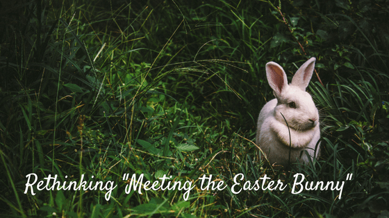 "white rabbit in grass. Text: Rethinking ""Meeting the Easter Bunny"""