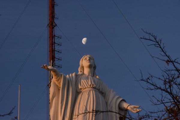 The Virgin Mary juggles the moon.