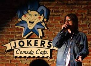 Mitch Hedberg on stage at Jokers