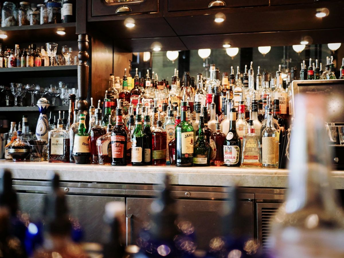 stay safe this party season by watching your drinking - picture of bar crammed with spirit bottles