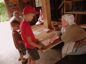Playing games in the Kid's Corner at Colonial Williamsburg