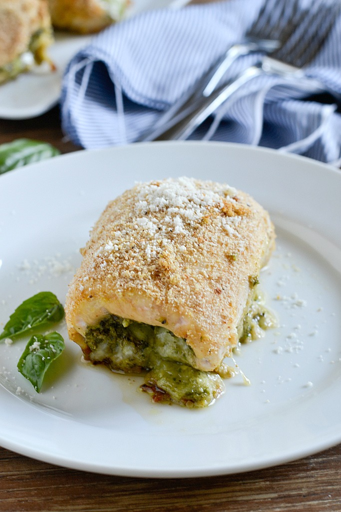 An easy recipe for Pesto Chicken Roll-Ups filled with fresh basil pesto and shredded mozzarella cheese then rolled up and coated with breadcrumbs for a delicious meal that is simple to make and yummy to eat.