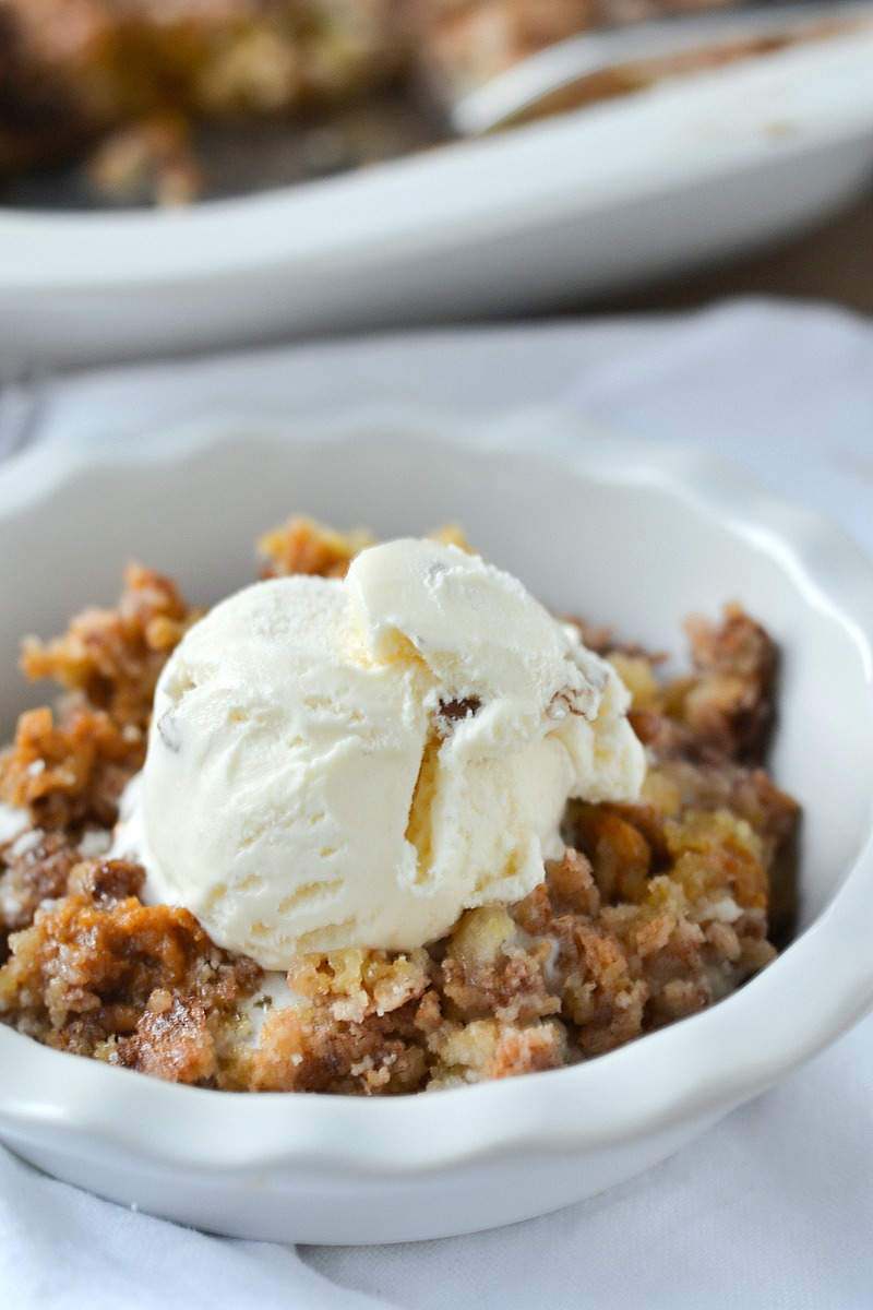 All the yummy flavors of fall come together in this super simple recipe for Snickerdoodle Pumpkin Cobbler made with a layer of sweet pumpkin topped with snickerdoodle cookie mix. | www.motherthyme.com