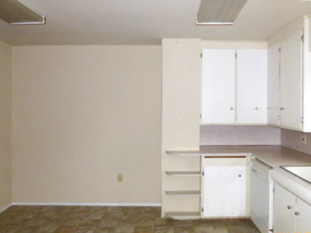dated kitchen with painted white cabinets