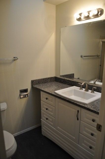 before house tour farmhouse bathroom with Hollywood lights granite counters and white cabinets