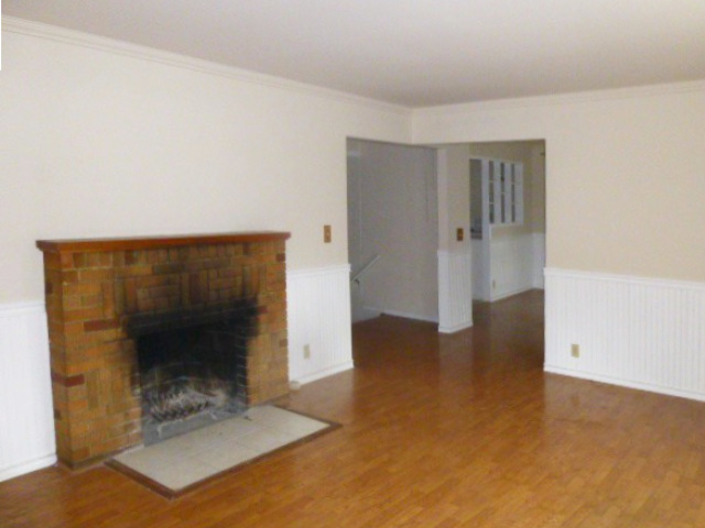 smoke stained fireplace living room with beadboard paneling