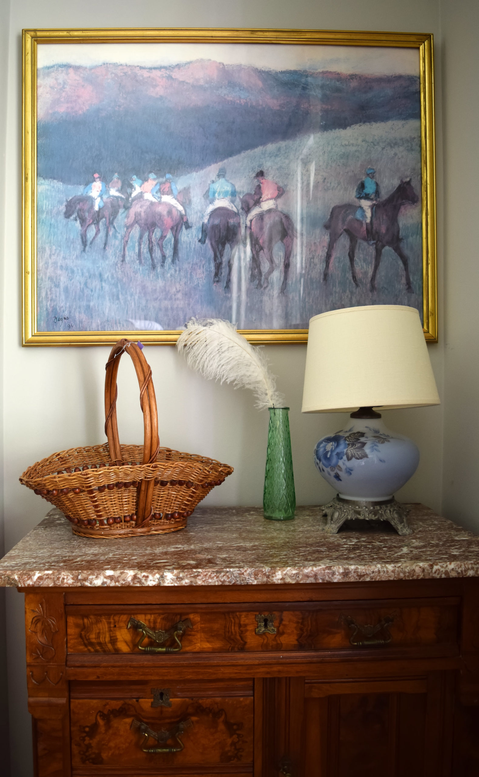 burlwood-cabinet-with-basket-blue-lamp-and-horse-painting-before-styling