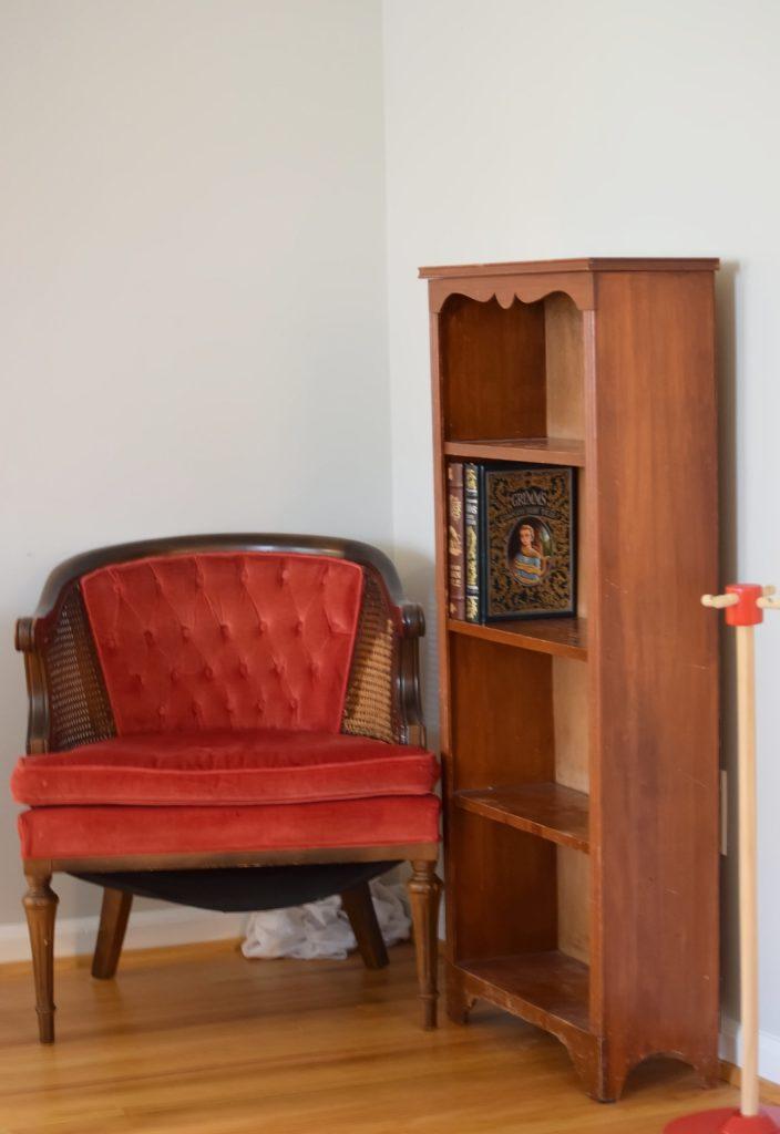 red chair and empty bookshelf in corner