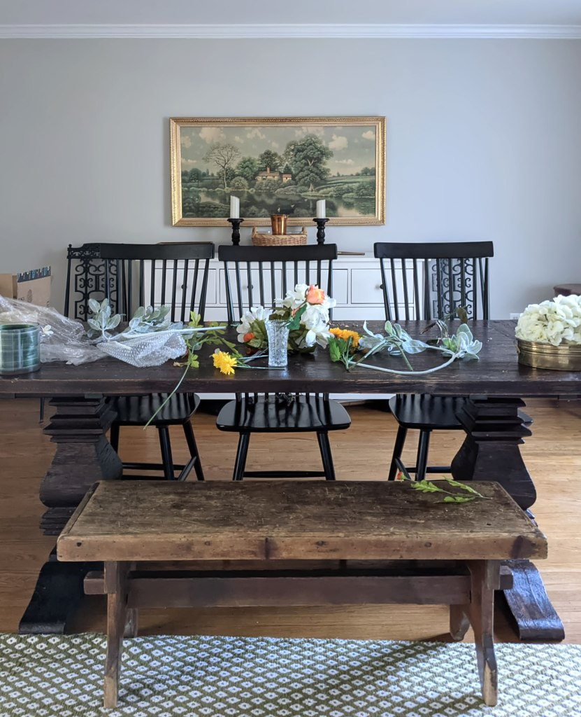 setting up to clean artificial flowers in dining room