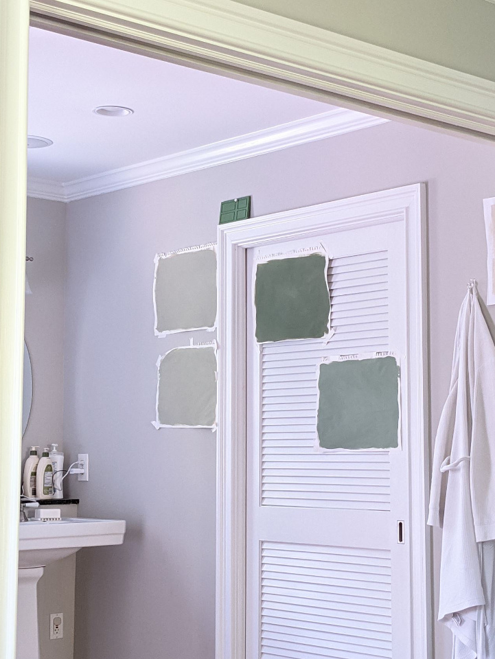 farrow and ball calke green card room vert de terre southern exposure swatch test bathroom wall and louvered pocket door with hanging robe