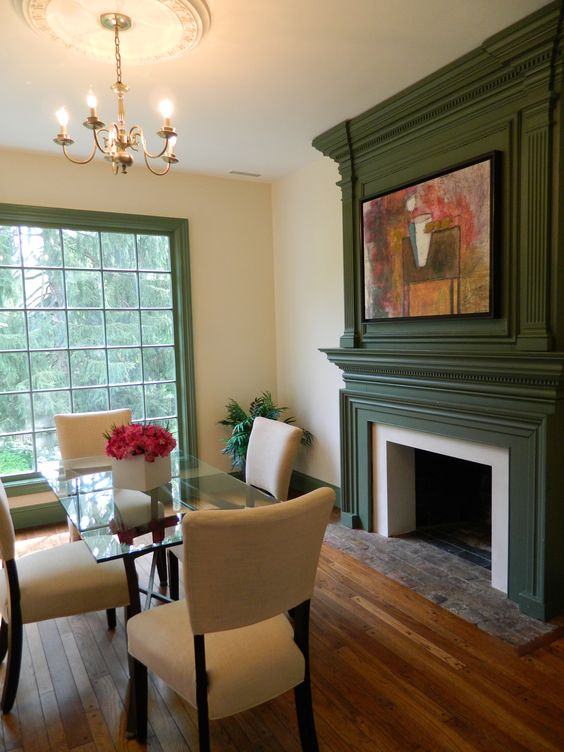 green trim on fireplace and window in dining area with brass