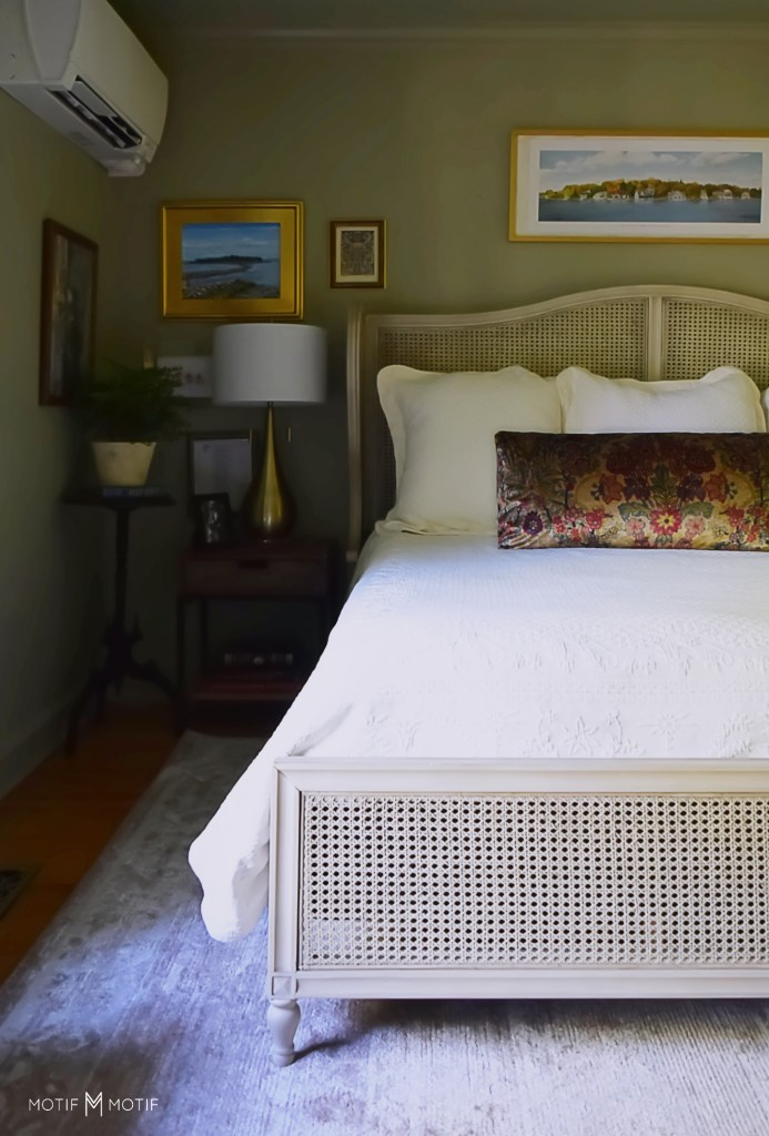 french cane bed with minisplit in green bedroom
