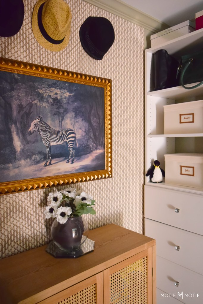 zebra painting and hats in walk in closet with crystal knobs