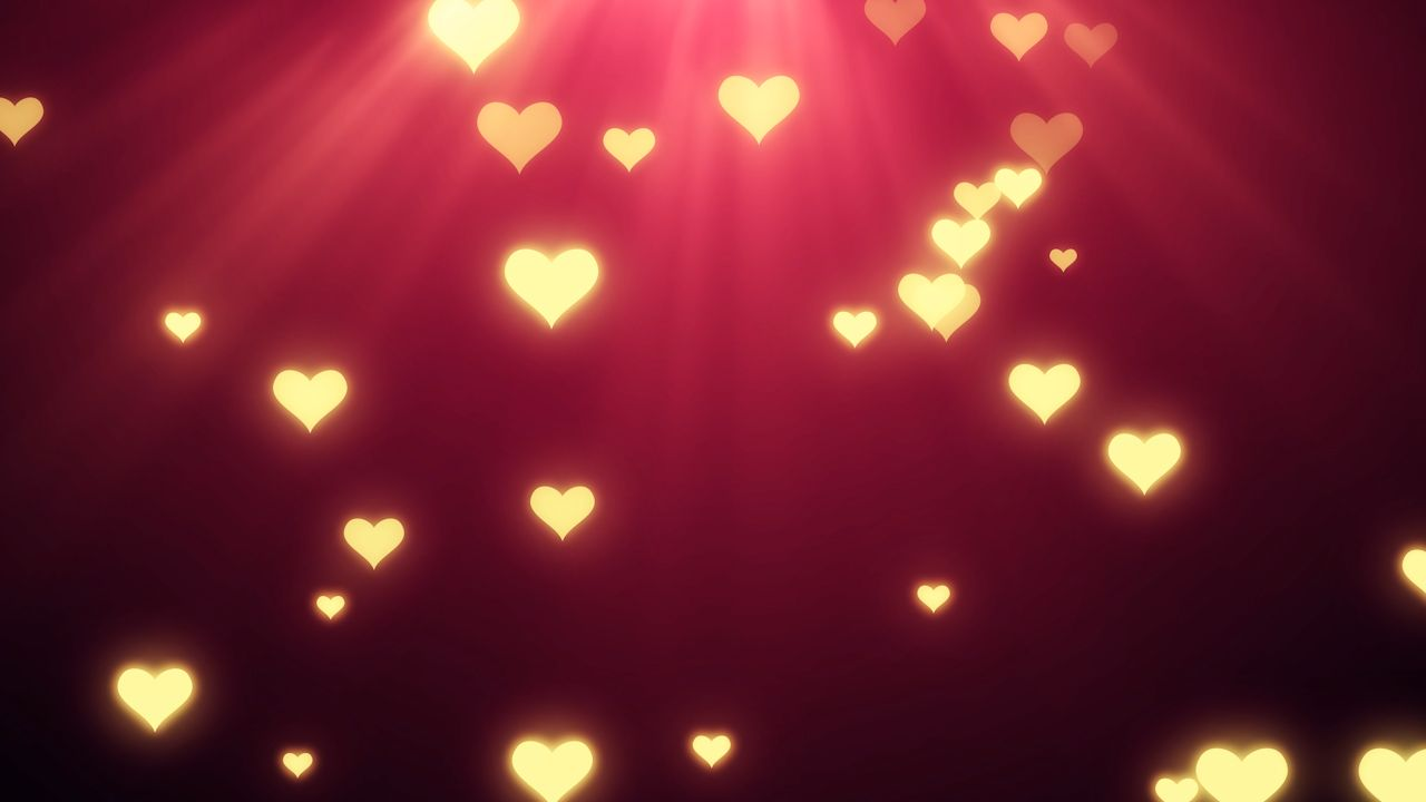 Hearts with light rays valentines background video