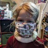 a kid wearing a mask