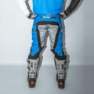 Back of adult blue engage motorsports pants