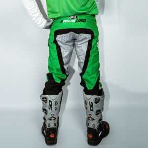 Back of adult green engage motorsports pants