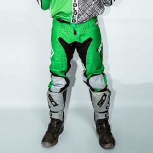 Front of adult green engage motorsports pants