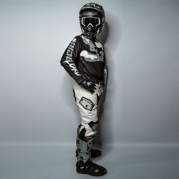 Side view of model wearing a complete white camo motocross kit