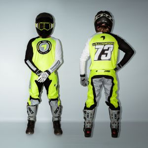 front & back view of model wearing yellow born 2 race motocross kit